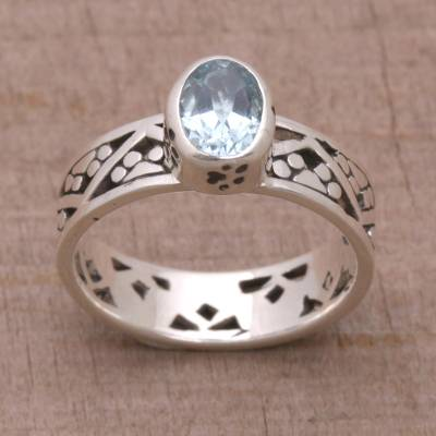 Blue topaz single stone ring, 'Paws for a Cause' - Blue Topaz and Sterling Silver Single Stone Ring from Bali