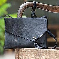 Leather sling handbag, 'Losari Tassel' - Coal Black Leather Sling Handbag Handmade in Indonesia
