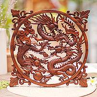 Wood wall panel, 'Raging Dragon Trio' - Handmade Suar Wood Panel of Fighting Dragons from Bali