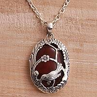 Carnelian pendant necklace, 'Avian Curiosity' - Carnelian and 925 Silver Bird Pendant Necklace from Bali