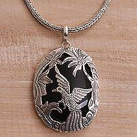Onyx pendant necklace, 'Cendrawasih Haven' - Onyx and Sterling Silver Bird Pendant Necklace from Bali