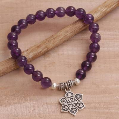 Amethyst beaded charm bracelet, 'Unity Flower' - Amethyst Religious Beaded Stretch Bracelet from Bali