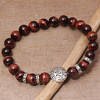 Men's tiger's eye beaded stretch bracelet, 'Temesir Om in Red' - Men's Tiger's Eye Beaded Om Stretch Bracelet from Bali
