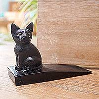 Wood doorstop, 'Helpful Kitten in Black' - Handcrafted Suar Wood Cat Doorstop in Black from Bali