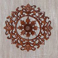 Wood wall relief panel, 'Compass Flower' - Artisan Hand-Carved Suar Wood Floral Wall Panel from Bali