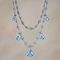 Blue topaz pendant necklace, 'Enchanted Droplets' - Sterling Silver and Blue Topaz Pendant Necklace from Java