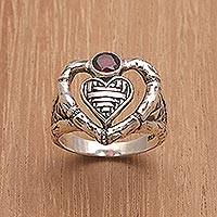 Garnet cocktail ring, 'Semarapura Heart' - Garnet Ring with Textured Sterling Silver Heart Motifs