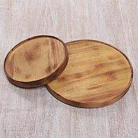 Small teakwood serving plates, 'Nature's Design' (pair) - Small Round Serving Plates Hand Carved of Teakwood (Pair)