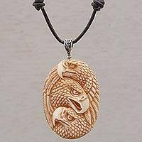 Bone pendant necklace, 'Eagle Trio' - Handcrafted Eagle-Themed Bone Pendant Necklace from Bali