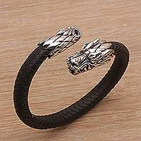 Men's sterling silver and leather cuff bracelet, 'Braided Dragon' - Men's Sterling Silver and Leather Dragon Bracelet from Bali
