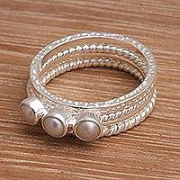 Sterling silver and cultured pearl stacking rings, 'United Moons' (set of 4) - 925 Sterling Silver Cultured Pearl Stacking Rings (Set of 4)