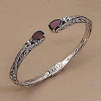 Garnet cuff bracelet, 'Looking for You' - Balinese Sterling Silver and Garnet Hinged Cuff Bracelet