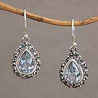 Blue topaz dangle earrings, 'Jepun Blue' - Frangipani Flower Dangle Earrings with Blue Topaz Gems