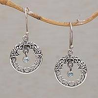 Blue topaz dangle earrings, 'Uluwatu Moon' - Blue Topaz Balinese Earrings Handcrafted of Sterling Silver