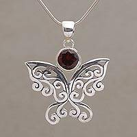 Garnet pendant necklace, 'Butterfly Secret' - Balinese Garnet and Sterling Silver Butterfly Necklace