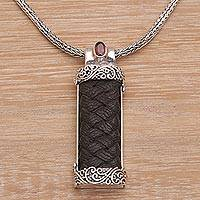 Garnet and leather pendant necklace, 'Strength and Grace' - Garnet and Leather Necklace in Sterling Silver from Bali