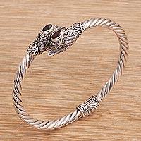 Garnet cuff bracelet, 'Fiery Eagles' (Indonesia)