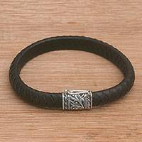 Men's leather and sterling silver wristband bracelet, 'Soul of a Dragon' - Men's Leather Braided Wristband Bracelet from Bali
