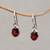 Garnet dangle earrings, 'Caressed by Paws' - Paw Print Faceted Garnet Dangle Earrings from Bali thumbail