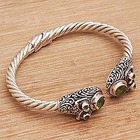 Peridot cuff bracelet, 'Wandering Eyes' (Indonesia)
