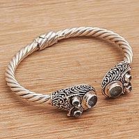 Blue topaz cuff bracelet, 'Wandering Eyes ' (Indonesia)