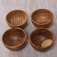 Teakwood condiment bowls, 'Delicious' (set of 4) - Hand Carved Teakwood Condiment Bowls (Set of 4)