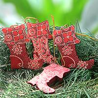 Wood batik ornaments, 'Java Stockings' (set of 4) - Four Batik Wood Stocking Ornaments from Java