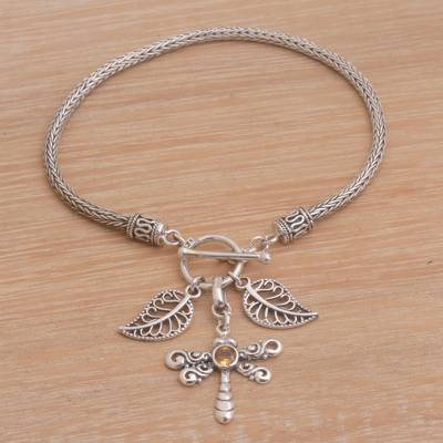 Citrine charm bracelet, 'Dragonfly Dawn' - Citrine and Silver Dragonfly Charm Bracelet from Bali