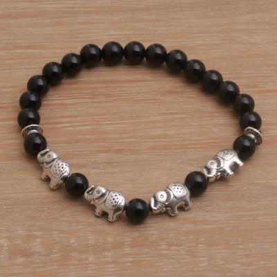 Onyx beaded stretch bracelet, 'Elephant Cavalcade in Black' - Sterling Silver and Onyx Beaded Stretch Bracelet from Bali