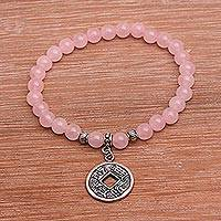 Rose quartz beaded stretch charm bracelet, 'Ancient Luck in Pink' - Rose Quartz Beaded Stretch Bracelet with Pis Bolong Coin