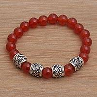 Carnelian beaded stretch bracelet, 'Jepun Sunset' - Carnelian Beaded Stretch Bracelet with Sterling Silver Beads
