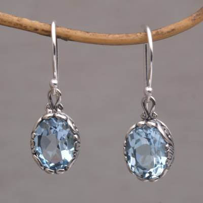 Blue topaz dangle earrings, 'Temptation Oval' - Blue Topaz Oval Faceted Dangle Earrings