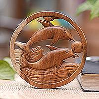 Wood wall relief panel, 'Fun with Dolphins' - Hand Carved Suar Wood Dolphin Wall Relief Panel from Bali