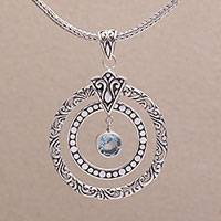 Blue topaz pendant necklace, 'Happy Sensation' - 925 Sterling Silver Blue Topaz Round Pendant Necklace