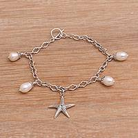 Cultured freshwater pearl charm bracelet, 'Sea Star' - Cultured Freshwater Pearl and Silver Starfish Charm Bracelet