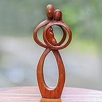 Wood sculpture, 'Infant Love' - Hand-Carved Suar Wood Parents and Newborn Family Sculpture
