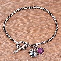 Blue topaz and amethyst charm bracelet,