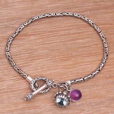 Blue topaz and amethyst charm bracelet, 'Lotus Sparkle' - Blue Topaz and Amethyst Charm Bracelet from Indonesia