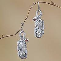 Garnet dangle earrings, 'Leafy Gleam' - Handcrafted Sterling Silver and Garnet Leaf Dangle Earrings