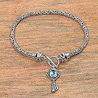 Blue topaz charm bracelet, 'Beauty Unlocked in Blue' - Blue Topaz and Sterling Silver Key Charm Bracelet from Bali