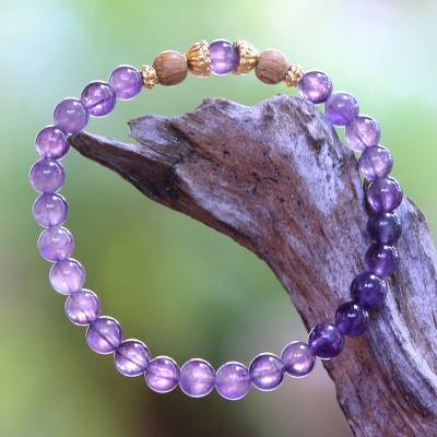 Gold accent amethyst beaded stretch bracelet, 'Batuan Tune' - Amethyst Beaded Bracelet with 22k Gold Plated Accents