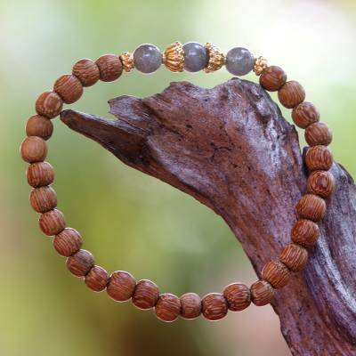 Gold accent wood and labradorite beaded stretch bracelet, 'Batuan Tune' - Coconut Wood and Labradorite Beaded Stretch Bracelet