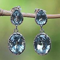Blue topaz dangle earrings, 'Vibrant Sky' - Bali Sterling Silver Faceted Blue Topaz Oval Dangle Earrings