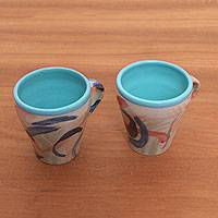 Ceramic cups, 'Blue Eden' (pair) - Hand-Painted Ceramic Cups in Blue from Java (Pair)