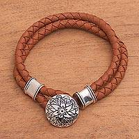Sterling silver and leather braided bracelet, 'Resilient Lotus' - Leather and Sterling Silver Bracelet with Lotus Pendant