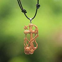 Bone pendant necklace, 'Faithful Sun and Moon' - Hand-Carved Bone Cross Pendant Necklace from Bali