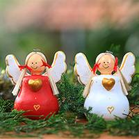 Wood statuettes, 'Heart Angels' (pair) - Red and White Wood Angel Statuettes from Bali (Pair)
