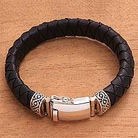 Braided leather and sterling silver bracelet, 'Jagaraga Swirl' - Sterling Silver and Braided Black Leather Bracelet