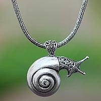 Blue topaz pendant necklace, 'Bunaken Snail' - Blue Topaz Snail Pendant Necklace from Java
