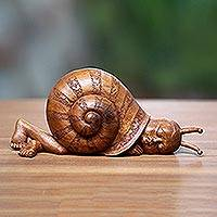 Wood sculpture, 'Slumbering Snail' - Snail-Themed Surrealist Suar Wood Sculpture from Indonesia